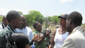 Journalists interview a woman at Ngozi Mine_